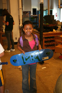 girl buying a skateboard