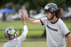 skateboarders giving each other a high five